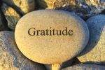Positive reinforcement word gratitude engraving on a rock